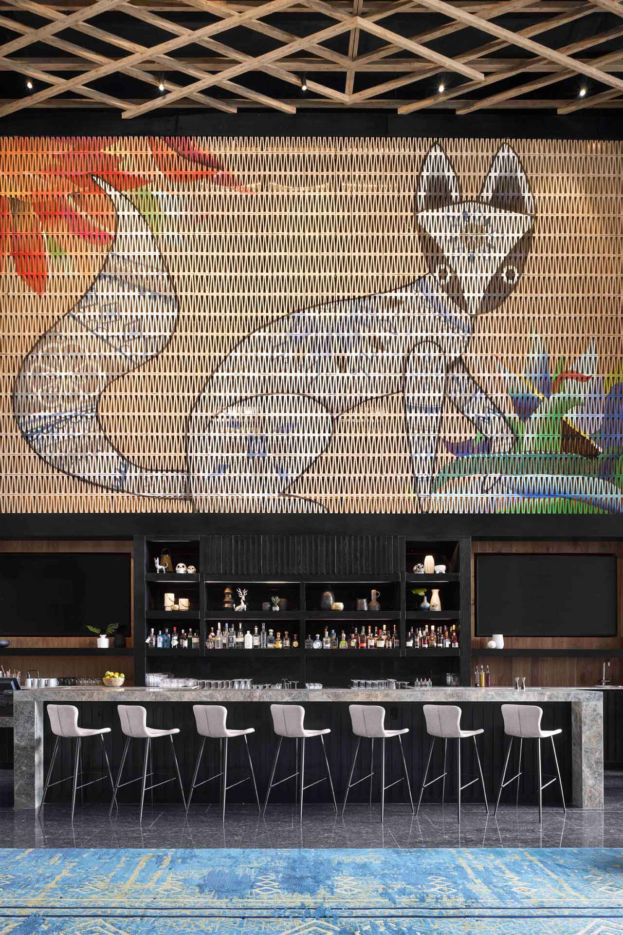 A mural by local artists hangs over the granite bar